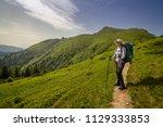 a girl hikers in the carpathian ... | Shutterstock . vector #1129333853