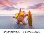 starfish surfer on the beach... | Shutterstock . vector #1129336523