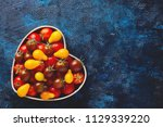 fresh delicious tomatoes in... | Shutterstock . vector #1129339220