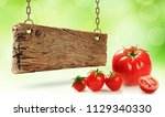 fresh tomatoes and wooden board | Shutterstock . vector #1129340330