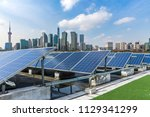 solar and modern city skyline | Shutterstock . vector #1129341299