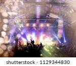 concert shot inside a venue ... | Shutterstock . vector #1129344830