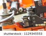 metal pipe bending machine | Shutterstock . vector #1129345553