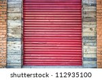 red metal garage rolled up door | Shutterstock . vector #112935100