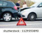 people discussing after a car... | Shutterstock . vector #1129353890