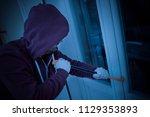 hooded housebreaker forcing... | Shutterstock . vector #1129353893