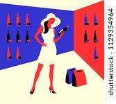 wine shopping. woman in a wine...   Shutterstock .eps vector #1129354964