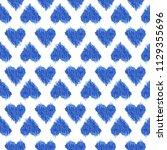 seamless pattern blue heart... | Shutterstock . vector #1129355696