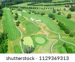 green grass of the golf course | Shutterstock . vector #1129369313