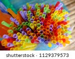 the brunch of colourful plastic ... | Shutterstock . vector #1129379573