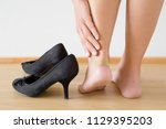 brown adhesive bandage on leg... | Shutterstock . vector #1129395203
