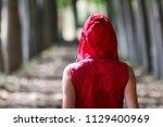 women dressed in red walking in ... | Shutterstock . vector #1129400969