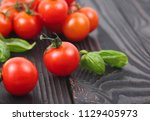 fresh cherry tomatoes on wooden ... | Shutterstock . vector #1129405973