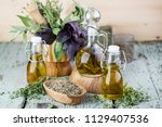 olive oil with herbs and spices ... | Shutterstock . vector #1129407536