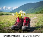 hiking boots and mountains... | Shutterstock . vector #1129416890