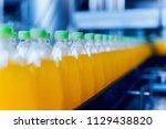 conveyor with bottles for juice ... | Shutterstock . vector #1129438820