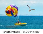 people flying with parachute... | Shutterstock . vector #1129446209
