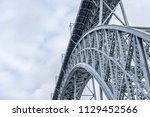 a fragment of maria pia bridge... | Shutterstock . vector #1129452566