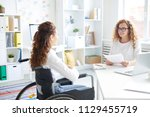 young employer and woman in... | Shutterstock . vector #1129455719