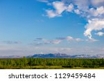 tundra and mountains of... | Shutterstock . vector #1129459484