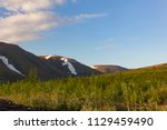 tundra and mountains of... | Shutterstock . vector #1129459490