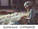 young girl with headphones... | Shutterstock . vector #1129460630