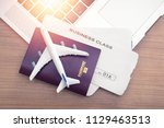 two tickets are on the table... | Shutterstock . vector #1129463513