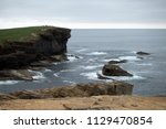 brown cliffs of a rocky coast... | Shutterstock . vector #1129470854