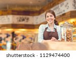 smiling woman in uniform in the ... | Shutterstock . vector #1129474400