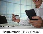 smile businessman holding... | Shutterstock . vector #1129475009