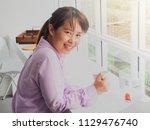asian business woman holding... | Shutterstock . vector #1129476740