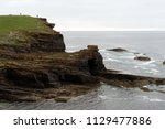 brown cliffs of a rocky coast... | Shutterstock . vector #1129477886