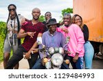 group of young people posing...   Shutterstock . vector #1129484993