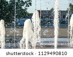 the fountain  the flow of water | Shutterstock . vector #1129490810