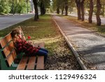 sad girl holds a lollipop and...   Shutterstock . vector #1129496324