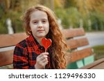 sweet little girl with a... | Shutterstock . vector #1129496330