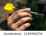 darts in hand  throwing | Shutterstock . vector #1129496576
