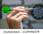 darts in hand  throwing | Shutterstock . vector #1129496579