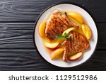 grilled pork chop with glazed... | Shutterstock . vector #1129512986