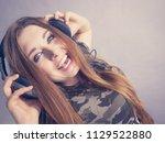 cheerful teenage woman... | Shutterstock . vector #1129522880