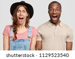 amazed interracial young pretty ... | Shutterstock . vector #1129523540