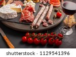 appetizers table with... | Shutterstock . vector #1129541396
