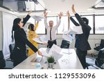 happy group of business people... | Shutterstock . vector #1129553096