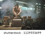 thai old man using mechanic... | Shutterstock . vector #1129553699