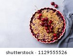 cherry  red berry crumble in... | Shutterstock . vector #1129555526