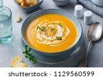 pumpkin and carrot soup with... | Shutterstock . vector #1129560599