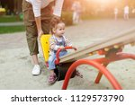 happy young mother with her... | Shutterstock . vector #1129573790