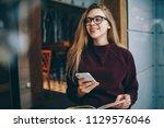 happy hipster girl wear in... | Shutterstock . vector #1129576046