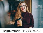 positive happy hipster girl in... | Shutterstock . vector #1129576073