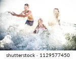 happy playful family on a...   Shutterstock . vector #1129577450